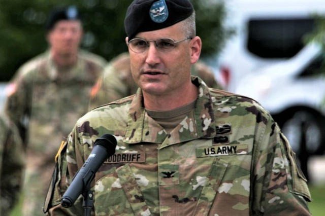 Col. David C. Woodruff Jr., new 181st Multi-Functional Training Brigade (MFTB) commander, talks to audience members after taking command of the unit during a change of command ceremony June 28, 2019, at Fort McCoy, Wis. Maj. Gen. Erik C. Peterson, commanding general of 1st Army Division West at Fort Hood, Texas, was the presiding officer for the ceremony. The 181st MFTB, a tenant organization at Fort McCoy, partners with Army Reserve and Army National Guard units to advise, assist, and train Army formations throughout their complete sustainable readiness model cycle to achieve collective training readiness in support of worldwide requirements. (U.S. Army Photo by Staff Sgt. Robert Larson, 181st Multi-Functional Training Brigade)