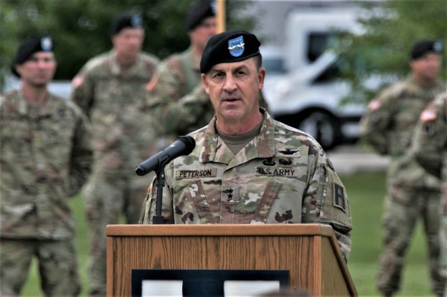 Maj. Gen. Erik C. Peterson, commanding general of First Army Division West at Fort Hood, Texas, talks to audience members during a change of command ceremony for the 181st Multi-Functional Training Brigade (MFTB) on June 28, 2019, at Fort McCoy, Wis. Peterson, was the presiding officer for the ceremony. The 181st MFTB, a tenant organization at Fort McCoy, partners with Army Reserve and Army National Guard units to advise, assist, and train Army formations throughout their complete sustainable readiness model cycle to achieve collective training readiness in support of worldwide requirements. (U.S. Army Photo by Staff Sgt. Robert Larson, 181st Multi-Functional Training Brigade)