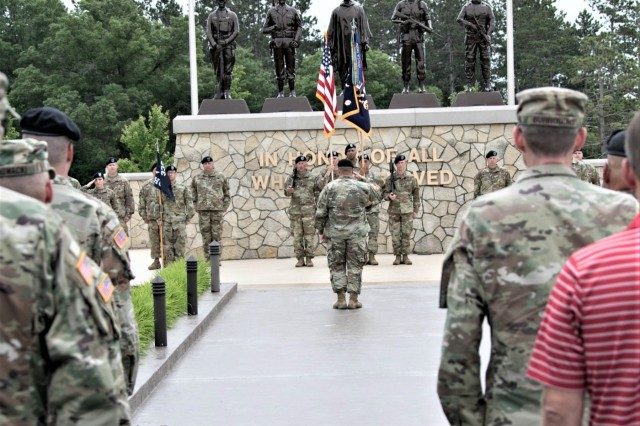 Soldiers with units affiliated with the 181st Multi-Functional Training Brigade (MFTB) stand in formation June 28, 2019, in front of Veterans Memorial Plaza at the Commemorative Area at Fort McCoy, Wis., during the change of command ceremony for the 181st. Maj. Gen. Erik C. Peterson, commanding general of First Army Division West at Fort Hood, Texas, was the presiding officer for the ceremony. The 181st MFTB, a tenant organization at Fort McCoy, partners with Army Reserve and Army National Guard units to advise, assist, and train Army formations throughout their complete sustainable readiness model cycle to achieve collective training readiness in support of worldwide requirements. (U.S. Army Photo by Staff Sgt. Robert Larson, 181st Multi-Functional Training Brigade)