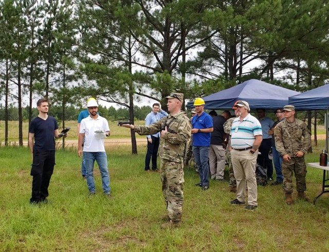 Soldiers examine unmanned aircraft prototypes