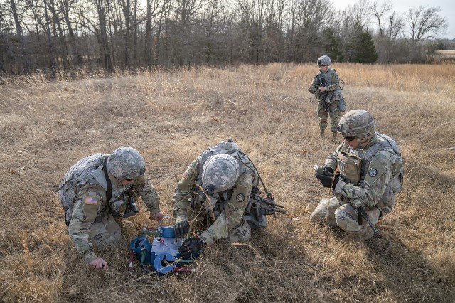 Combat engineers emplace Spider Activated Volcano Obstacle prototypes at the Focused Assessment, held Dec. 3-14 at Fort Leonard Wood, Missouri. (Photo courtesy of New Equipment Training and Media Production, Picatinny Arsenal)