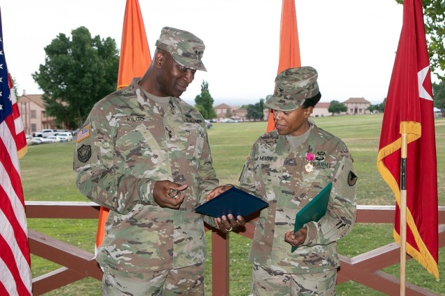 FORT HUACHUCA, Ariz. - Maj. Gen. Mitch Kilgo, commanding general of the U.S. Army Communications-Electronics Command, shares a private moment with the outgoing ISEC Commander, Col. Nicole R. Morris, at ISEC's change of command ceremony, July 12, 2019.