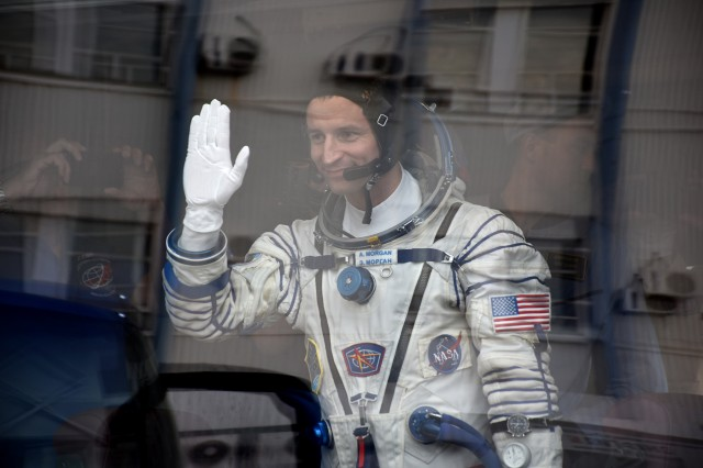 NASA astronaut Col. Andrew Morgan waves to family as he leaves on the bus to the launch site of the Soyuz MS-13 at the Baikonur Cosmodrome in Kazakhstan, July 20, 2019.