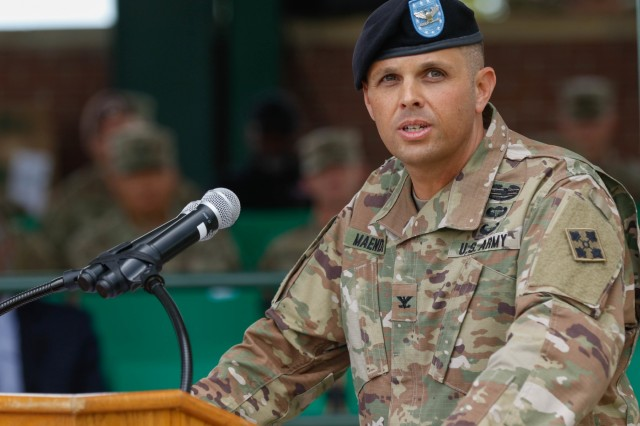 Col. Ryan O. Maender, commander of the 4th Division Artillery, addresses Soldiers and invited guests in his welcome speech during a change-of-command ceremony at Founders Field, Fort Carson, Colorado, June 13, 2019. The act of the passing of colors is symbolic of the passing of the command authority. (U.S. Army photo by Sgt. Daphney Black)