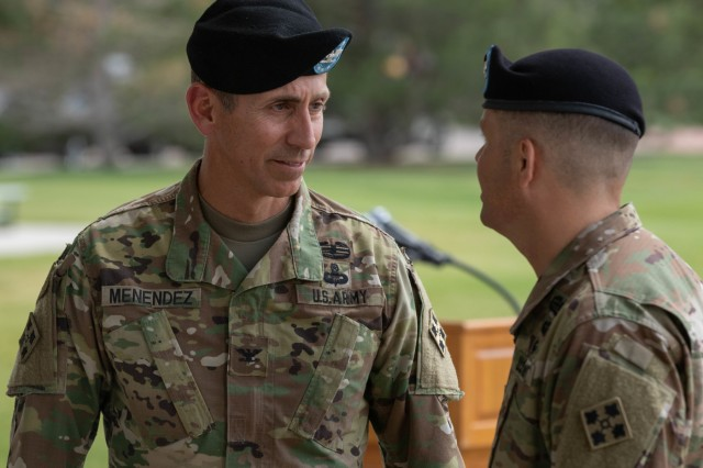 Col. Norberto Menéndez, left, outgoing commander, 4th Division Artillery, and Col. Ryan Maender, incoming commander, exchange words moments following the change-of-command ceremony at Founders Field, Fort Carson, Colorado, June 13, 2019. Menéndez joined DIVARTY on July 10, 2017. (U.S. Army photo by Spc. Robert Vicens)