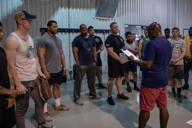 Soldiers stationed at Mihail Kogalniceanu Air Base, Romania, get a brief of the rules before competing in the 1000 Pound Challenge June, 25, 2019. The 1000 Pound Challenge is a weightlifting event consisting of a squat, bench press and deadlift. The 1000 Pound Club is a way to acknowledge the physical achievement and dedication to training at the MKAB fitness centers.