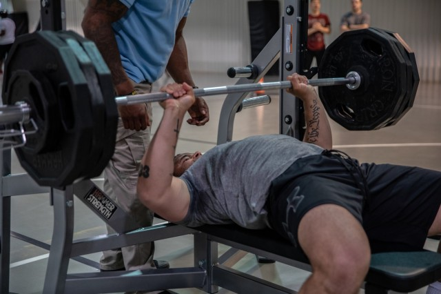 Spc. Zane Adams, 1st Engineer Battalion, Fort Riley, Kan., completes the second event, a 375 pound benchpress, in the 1000 Pound Challenge June, 25 2019, at Mihail Kogalniceanu Air Base, Romania. The 1000 Pound Challenge is a weightlifting event consisting of a squat, bench press and deadlift. The 1000 Pound Club is a way to acknowledge the physical achievement and dedication to training at the MKAB fitness centers.
