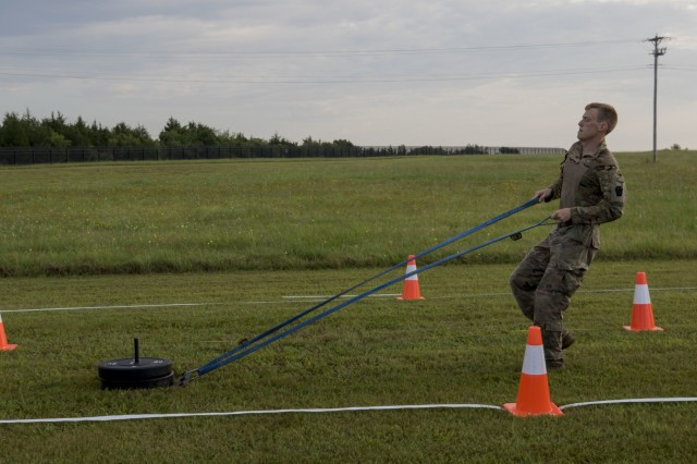 Spc. Hunter Olsen, a member of the Maryland Army National Guard, shows his strength during the sprint-drag-carry event of the modified Army Combat Fitness Test as part of the  Army National Guard Best Warrior competition at Camp Gruber Training Center, Oklahoma, July 17, 2019.  The Army National Guard Best Warrior Competition is the culminating test for the top 14 noncommissioned officers and Soldiers from seven regions across the nation who compete in a week-long test of soldiering skills and abilities to take home the title of 2019 Army National Guard Soldier and NCO of the Year.