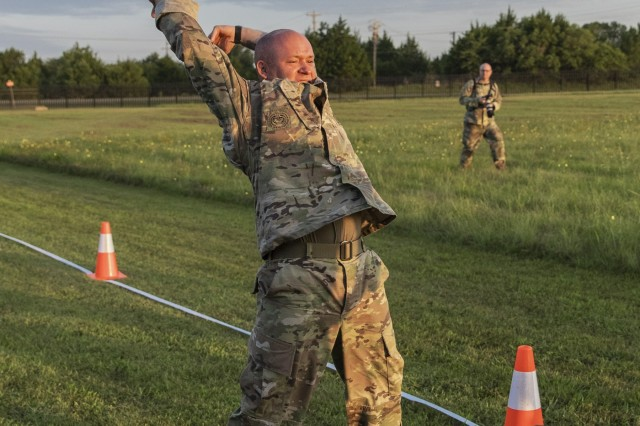 Sgt. 1st Class Jamison Yager, Michigan National Guard, takes part in a modified ACFT during the 2019 Army National Guard Best Warrior Competition at Camp Gruber Training Center, Oklahoma, July 17, 2019.The 2019 Army National Guard Best Warrior Competition is the culminating test for the top 14 noncommissioned officers and Soldiers from seven regions across the nation who to compete in a week-long test of soldiering skills and abilities to take home the title of 2019 Army National Guard Soldier and NCO of the Year. (Oklahoma Army National Guard photo by Kendall James).