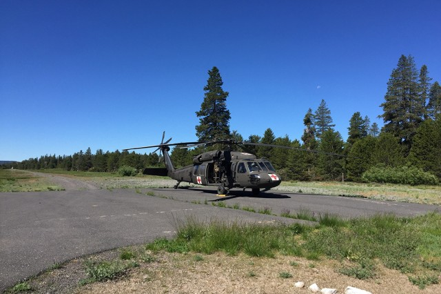 A UH-60 Black Hawk helicopter from the California Army National Guard's Army Aviation Support Facility #3 in Mather, California, lands in Bear Valley after rescuing a lost hiker in rugged, mountainous terrain near Lake Alpine, Monday morning, July 22, 2019. The hiker was reported missing after failing to meet up with another hiker July 19 near Lake Alpine. The Cal Guard was activated Sunday night by the California Governor's Office of Emergency Services to assist Alpine County Sheriff's Department on the search.
