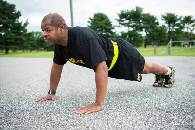 Lt. Col. Ronald Cole, a public health nurse with the Army Public Health Center, performs push-ups June 21, 2019, as part of his physical training before competing in his ninth Army Ten-Miler race to be held in October. APHC experts recommend following the Performance Triad of sleep, activity and nutrition with any training regimen.