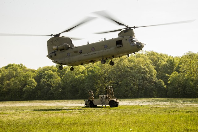 Soldiers with the 237th Support Battalion connect a vehicle load beneath a CH-47 Chinook helicopter of B Company, 3rd Battalion, 238th Aviation Regiment May 19, 2019, at Camp James A. Garfield Joint Military Training Center near Newton Falls, Ohio. These units conducted comprehensive training in sling load operations, which greatly enhances Ohio National Guard combat support capability and disaster relief responsiveness.