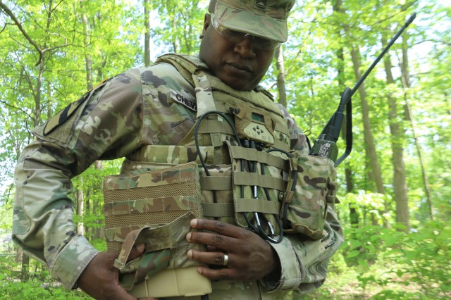 Sgt. 1st Class Edvar Chevalier demonstrates a prototype of the Conformal Wearable Battery that incorporates silicon-anode technology at Aberdeen Proving Ground, Md., in June 2019.