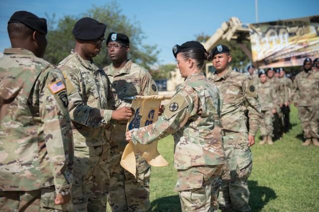 The command team for the 553rd Field Feeding Company, Capt. Aramis M. Brewington, and 1st Sgt. Katrina M. Munoz, unfurl their unit guidon during the ceremony July 23.  The Vikings of the 553rd FFC, 61st Quartermaster Battalion, 13th Expeditionary Sustainment Command, held an activation and assumption-of-command ceremony on Hildner Field officially activating the unit as the Army's eighth FFC. (U.S. Army photo by Sgt. 1st Class Kelvin Ringold)