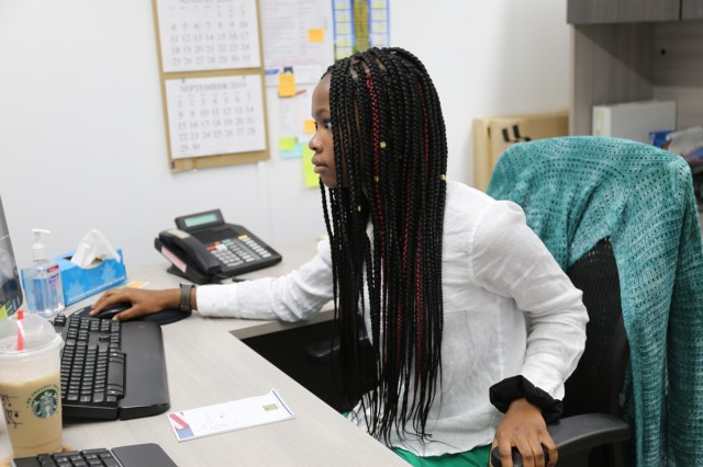 Sierra Zantt, an employee taking part in Camp Zama, Japan's summer hire program for high school- and college-age students, works on a computer at the front desk of Army Community Service.