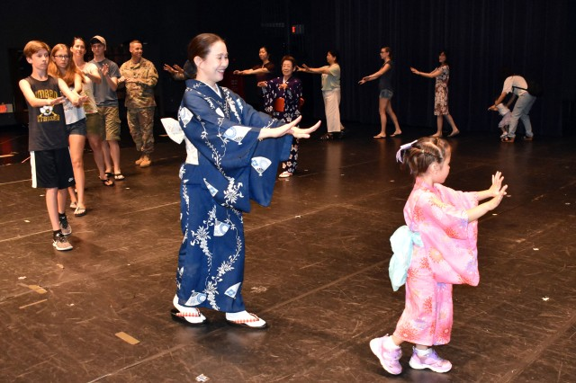 Members of the Camp Zama community learn a Bon dance at the Community Recreation Center, Camp Zama, Japan, July 18.