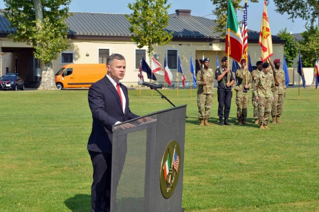 Tommy R. Mize, region director, Installation Management Command-Europe, addresses the audience during the USAG Italy change of command ceremony on Hoekstra Field, Caserma Ederle, Vicenza, Italy, July 24, 2019.