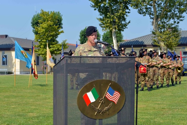 Col. Erik M. Berdy, outgoing garrison commander, addresses the audience at the USAG Italy change of command ceremony at Hoekstra Field on Caserma Ederle, July 24, 2019. Berdy relinquished command of the garrison to Col. Daniel J. Vogel, who comes to Italy from the Army War College.