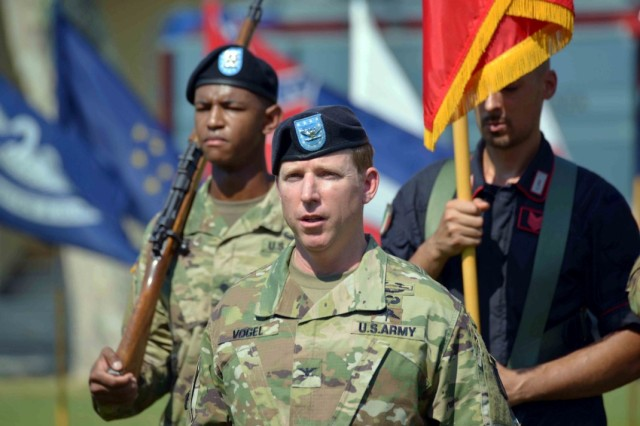 Col. Daniel J. Vogel, incoming commander, U.S. Army Garrison Italy, takes command of the troops during the garrison change of command ceremony on Hoekstra Field, Caserma Ederle, Vicenza, Italy, July 24, 2019.