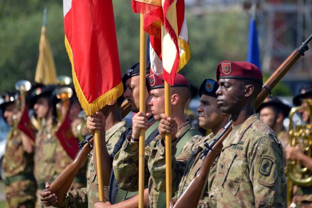 Soldiers from the United States Army Garrison Italy and a soldier from the Italian Carabinieri present the national flags of the United States and Italy, as well as the colors of USAG Italy, during the change of command ceremony at Caserma Ederle, Vicenza, Italy, July 24, 2019.