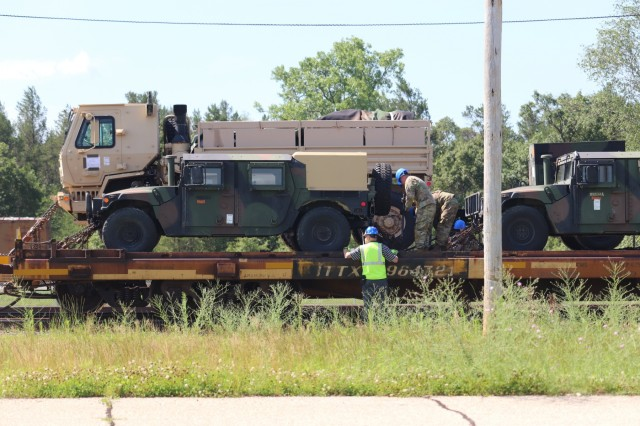 Military vehicles and equipment belonging to the 1158th Transportation Company of the Wisconsin National Guard are loaded on railcars July 10, 2019, at Fort McCoy, Wis. The company is shipping the equipment to Fort Hood, Texas, to be a part of a large exercise later in the year. The rail loading and related work was completed by 1158th Soldiers and employees with the Fort McCoy Logistics Readiness Center Transportation Division. (U.S. Army Photo by Scott T. Sturkol, Public Affairs Office, Fort McCoy, Wis.)