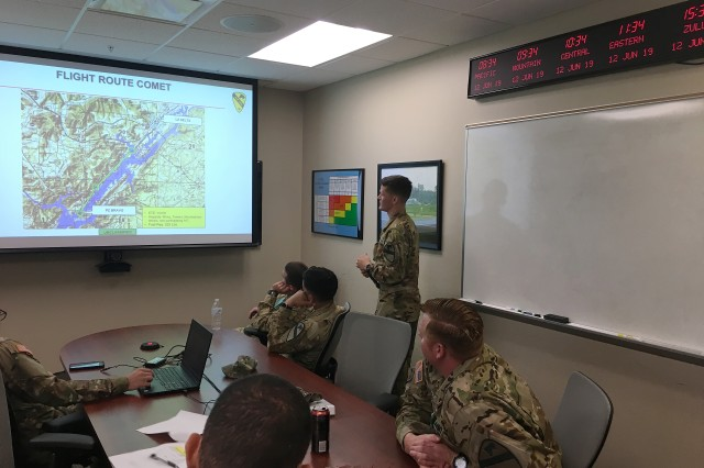 1st Lt. Peter Zeidler, test unit officer-in-charge with the 3rd Assault Helicopter Battalion, 227th Aviation Regiment, 1st Air Cavalry Brigade, 1st Cavalry Division, conducts an Air Mission Brief for pilots and crew chiefs prior to an Air Assault mission during operational testing of the Common Infrared Countermeasures (CIRCM) at the Redstone Test Center, Redstone Arsenal, Ala.