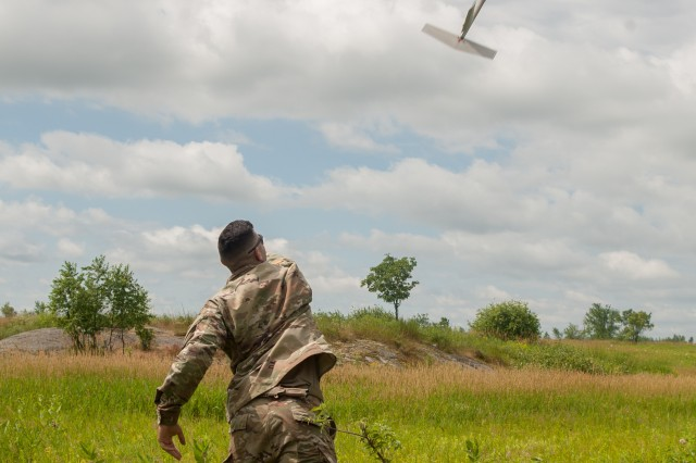 Cpl. Matthew Mena, field artillery tactical data system specialist assigned to Charlie Battery, 1st Battalion, 258th Field Artillery Regiment, launches an RQ-11B Raven small unmanned aircraft system during the unit's annual training at Fort Drum, NY, July 21. During the training, Soldiers across the 27th Infantry Brigade Combat Team were able to log flight time on the Raven to keep their operator certifications current.