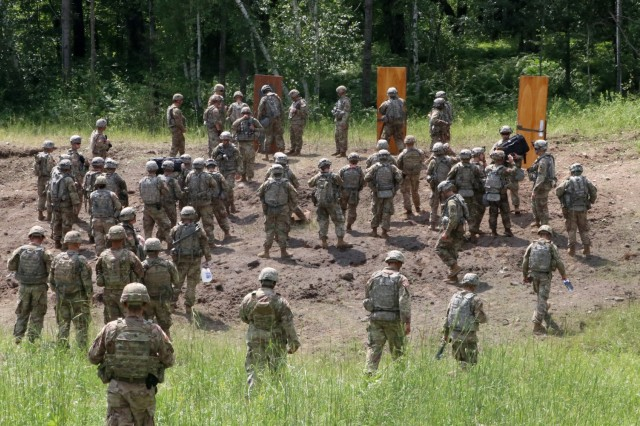 Iowa National Guard and 101st Airborne Division engineer Soldiers prepare to conduct a live urban breach during an eXportable Combat Training Capability rotation at Camp Ripley, Minn., on July 15, 2019. The National Guard and active duty units had the opportunity to train together as part of their working relationship.
