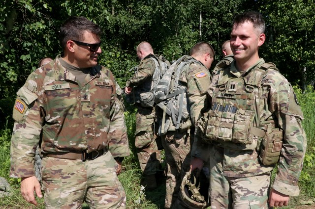 1st Sgt. Jeremy Cole, first sergeant of Company A, 1st Battalion, 326th Brigade Engineer Battalion (BEB), 1st Brigade Combat Team, 101st Airborne Division, and Capt. Thomas Bentley, of Chaska, Minn., commander of Company A, 224th Brigade BEB, 2nd Infantry Brigade Combat Team, 34th Infantry Division, Iowa Army National Guard (IANG), share a laugh as they prepare to give demolition classes during an eXportable Combat Training Capability rotation at Camp Ripley, Minn., on July 15, 2019. The National Guard and active duty units had the opportunity to train together as part of their working relationship.