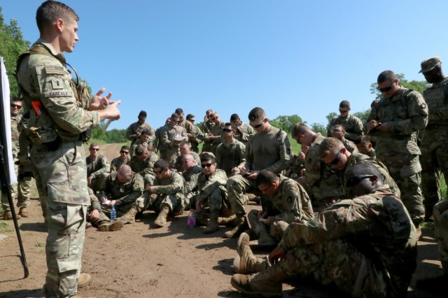 1st Lt. Alexander Pascale, an engineering officer with Company A, 1st Battalion, 326th Brigade Engineer Battalion, 1st Brigade Combat Team, 101st Airborne Division (101st ABN), teaches a class to Iowa National Guard and 101st ABN Soldiers on improvised claymore mines during an eXportable Combat Training Capability rotation at Camp Ripley, Minn., on July 15, 2019. The National Guard and active duty units had the opportunity to train together as part of their working relationship.