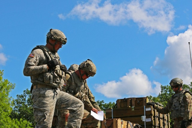 Soldiers with Company F, 334th Brigade Support Battalion, 2nd Infantry Brigade Combat Team, 34th Infantry Division, Iowa Army National Guard (IANG), delivers artillery ammunition for supporting units during an eXportable Combat Training Capability (XCTC) rotation at Camp Ripley, Minn., on July 21, 2019. IANG Soldiers are participating in the 21-day exercise, which will train them in dynamic and challenging scenarios, including night operations and live-fire exercises.