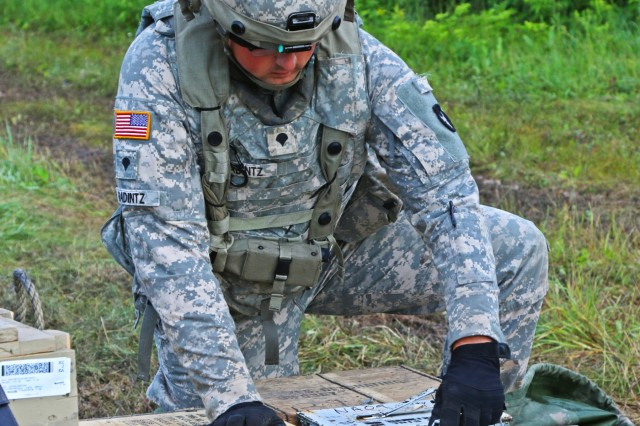 Spc. Garrett Radintz, of Albert City, Iowa, a motor transport operator with Company F, 334th Brigade Support Battalion, 2nd Infantry Brigade Combat Team, 34th Infantry Division, Iowa Army National Guard (IANG), prepares artillery ammunition for supporting units during an eXportable Combat Training Capability (XCTC) rotation at Camp Ripley, Minn., on July 21, 2019. IANG Soldiers are participating in the 21-day exercise, which will train them in dynamic and challenging scenarios, including night operations and live-fire exercises.