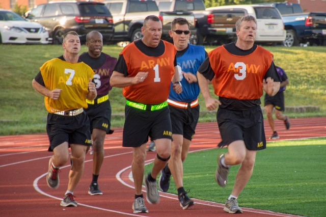 Commanders and Command Sergeants Major compete in the 2-mile run during the School for Command Preparation's first diagnostic Army Combat Fitness Test July 13.