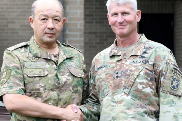 Maj Gen. Kurt Sonntag, commanding general, U.S. Army John F. Kennedy Special Warfare Center and School, and Maj Gen.Bakhodir Kurbanoz, the minister of defense for the Republic of Uzbekistan, pose for a photo after a tour and training capabilities brief of Special Operations Medical Training Center, Fort Bragg, North Carolina, July 10, 2019. (Photo by: U.S. Army Sgt. Brandon Allums, USASOC Public Affairs)