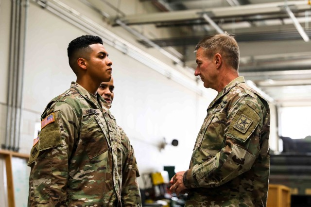 Pvt. Andy Cortez, a Soldier with 6th Squadron, 1st Cavalry Regiment, 1st Armored Brigade Combat Team, 1st Armored Division, receives a challenge coin for excellence from Gen. James C. McConville, the Vice Chief of Staff of the Army, at Fort Bliss, Texas, July 22. Cortez, a native of El Paso, Texas, has displayed a sense of selfless service and initiative despite only being in the unit for three months, training on equipment outside of his job scope and ensuring that he is technically proficient in his position, which contributed to the success of the brigade's conversion to an armored formation. (U.S. Army photo by Spc. Matthew J. Marcellus)
