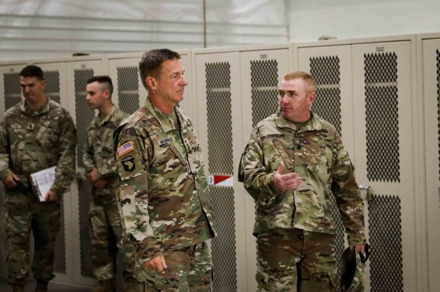 Lt. Col. Michael B. Throckmorton, the commander of 6th Squadron, 1st Cavalry Regiment, 1st Armored Brigade Combat Team, 1st Armored Division, prepares to provide a tour of his battalion's motor pool area to Gen. James C. McConville, the Vice Chief of Staff of the Army, at Fort Bliss, Texas, July 22. 1ABCT leaders demonstrated their training standards and readiness to McConville, displaying the results of their recent conversion from a Stryker brigade into an armored brigade combat team. (U.S. Army photo by Spc. Matthew J. Marcellus)