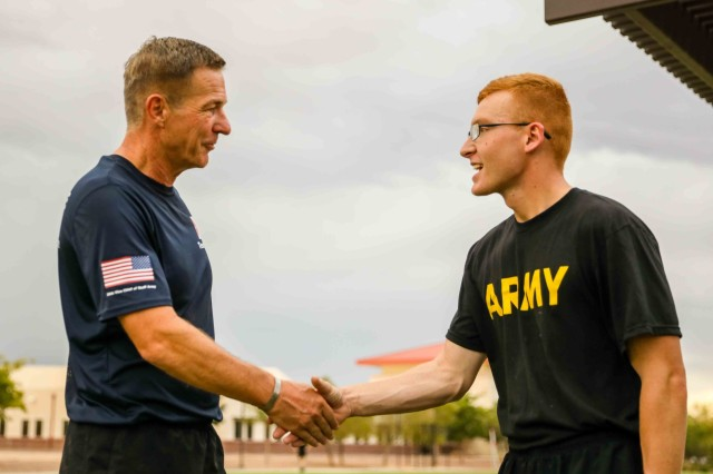 Sgt. Scott Frymire, right, a section sergeant for the fueling segment of Company I, 1st Battalion, 36th Infantry Regiment, 1st Armored Brigade Combat Team, 1st Armored Division, receives a challenge coin for excellence from Gen. James C. McConville, the Vice Chief of Staff of the Army, at Fort Bliss, Texas, July 22. Frymire was previously selected as the NCOIC for the 1-36 IN color guard, won a Noncommissioned Officer of the Quarter competition and has dedicated his time to volunteering outside of work, representing excellence in dedication and motivation to the Army and community. (U.S. Army photo by Spc. Matthew J. Marcellus)