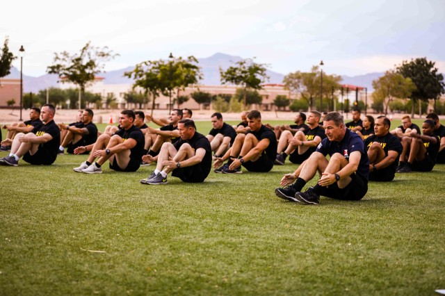Soldiers assigned to 1st Battalion, 36th Infantry Regiment, 1st Armored Brigade Combat Team, 1st Armored Division and Gen. James C. McConville, the Vice Chief of Staff of the Army, front right, perform the preparatory drill during a physical training (PT) event at Fort Bliss, Texas, July 22. The 1ABCT demonstrated physical readiness as well as new equipment fielding and training during transition from a Stryker to an armored brigade combat team to McConville during his visit to Fort Bliss July 22. (U.S. Army photo by Spc. Matthew J. Marcellus)