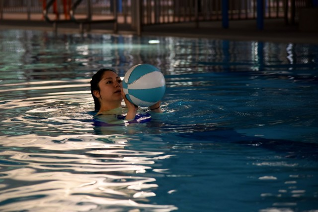 Pfc. Heaven Ramirez, a public affairs specialist with American Forces Network Daegu, prepares to shoot a basketball at the Camp Walker Aquatics Center, Republic of Korea. The Camp Walker Aquatics Center has designated 6 to 8 a.m. for physical training and grants free access to Soldiers during that time.