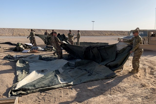 Soldiers of the 129th Support Battalion conduct a Level II Deployment Readiness Exercise to test their ability to go from an alert to establishing mission critical communication and life support systems at Camp Buehring, Kuwait, July 13, 2019. (U.S. Army photo by Capt. Christian Turley)
