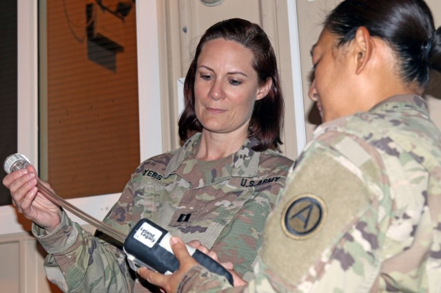 Capt. Jessica Myers, 3d Medical Command Deployment Support - Forward,  conducts an air quality assessment with Sgt. 1st Class Nichaya Srisark, Area Support Group - Qatar, at Camp As Sayliyah, Qatar, July 19, 2019. (U.S. Army National Guard photo by Sgt. Connie Jones)