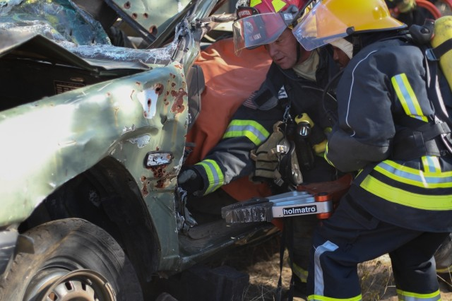 Firefighters with the Botswana Defense Force and the North Carolina National Guard work together to rescue simulated car crash victims and put out a fire during a training exercise at Thebephatshwa Air Base in Botswana on July 16, 2019.