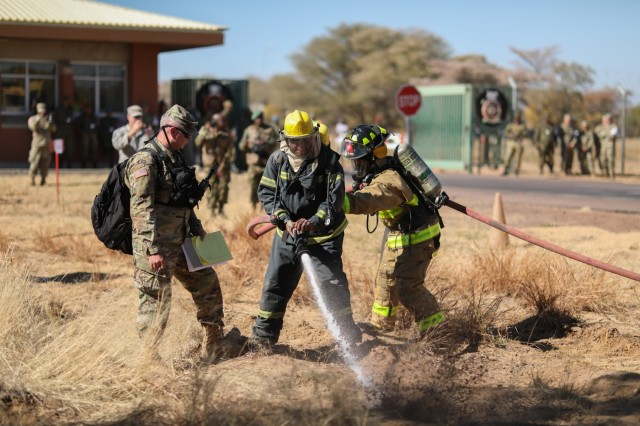 Firefighters with the Botswana Defense Force and the North Carolina National Guard work together to rescue simulated car crash victims and put out a fire during a training exercise at Thebephatshwa Air Base in Botswana on July 16, 2019. The exercise was part of a two day culminating event after more than 170 Army and Air Guardsmen from North Carolina, Alabama, and New Jersey trained in partnership with their Botswana Defense Force counterparts during Upward Minuteman 2019, a U.S. Africa Command exercise promoting the U.S. National Guard's State Partnership Programs on the African Continent.