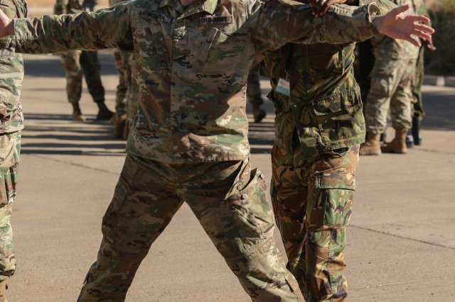 Private 1st Class Devin Pittman, with the Alabama National Guard's 214th Military Police Company, is searched by a service member with the Botswana Defense Force during a personnel search class at Thebephatshwa Air Base in Botswana on July 14, 2019. More than 170 Army and Air Guardsmen from North Carolina, Alabama, and New Jersey are training in partnership with their Botswana Defense Force counterparts during Upward Minuteman 2019, a U.S. Africa Command exercise promoting the U.S. National Guard's State Partnership Programs on the African Continent.
