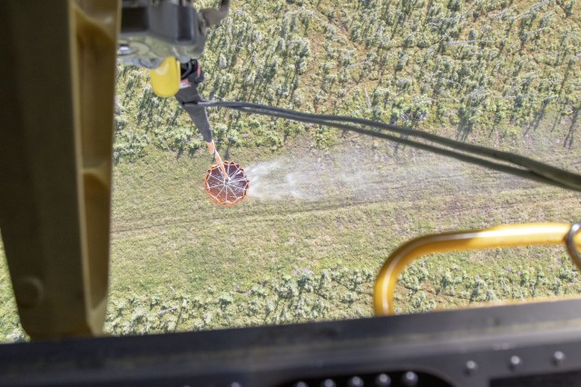 Alaska Army National Guard 1st Battalion, 207th Aviation aircrew practices fire suppression support training using a Bambi water bucket in a CH-47 Chinook helicopter near Joint Base Elmendorf-Richardson, July 16, 2019. 1-207th AVN aircrews have supported multiple fire suppression missions this summer with UH-60 Black Hawks. The Chinooks -- a new aircraft to the 207th AVN inventory this year -- provided wildfire suppression support for the first time ever July 8 at the Swan Lake Fire in the Kenai National Wildlife Refuge near Sterling, Alaska. The Chinooks and Black Hawks continuously train to remain proficient and ready to respond to missions as needed.