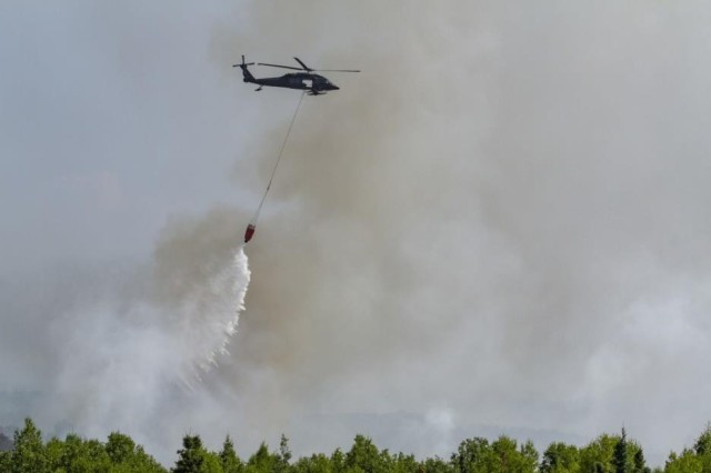 Alaska Army National Guard UH-60 Black Hawk crews from 1-207th Aviation operate in support of Department of Forestry crew to fight a wildfire at Montana Creek near Talkeetna, Alaska, July 4, 2019.