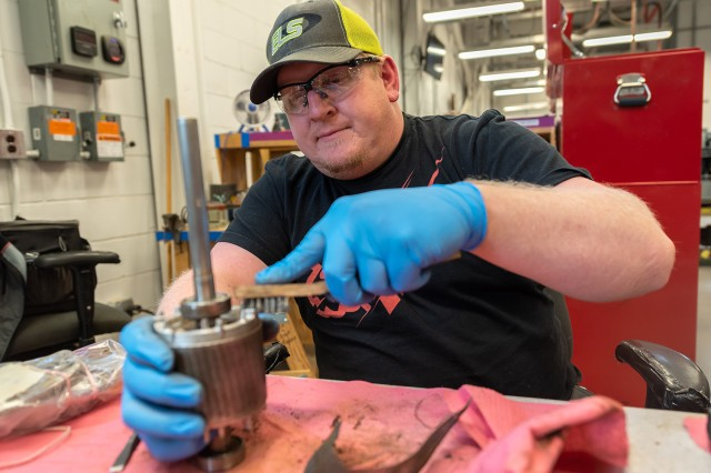 Travis Heller cleans components in support of Tobyhanna air conditioner overhaul workload. The Air Force veteran has found a second career as a Tobyhanna intern.