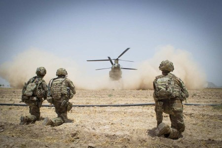 Paratroopers assigned to the 3rd Brigade Combat Team, 82nd Airborne Division, secure a helicopter landing zone for a CH-47 Chinook Helicopter, July 20, 2019, in Kandahar Province, Afghanistan. The Paratroopers provided protection to a nearby meeting between U.S. and Afghan officials discussing peace and security within the region.
