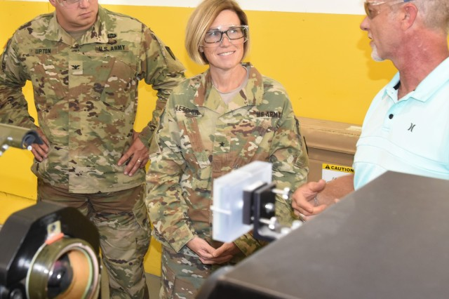 MCAAP's Tim Easley briefs JMC Commanding General, Brig. Gen. Michelle M. T. Letcher, on current missile systems at the Missile Maintenance Facility, July 25, as MCAAP Commander, Col. Shane Upton looks on.