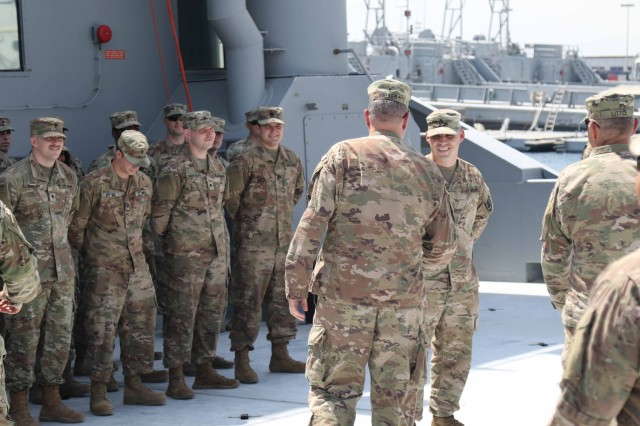 Brig. Gen. Clint E. Walker, deputy commanding general of 1st Theater Sustainment Command, greets the Soldiers of 97th Transportation Company while aboard U.S. Army Landing Craft Utility Vessel Molino Del Ray (LCU-2029) at Kuwait Naval Base, Kuwait, July 23, 2019. (U.S. Army National Guard photo by Sgt. Connie Jones)